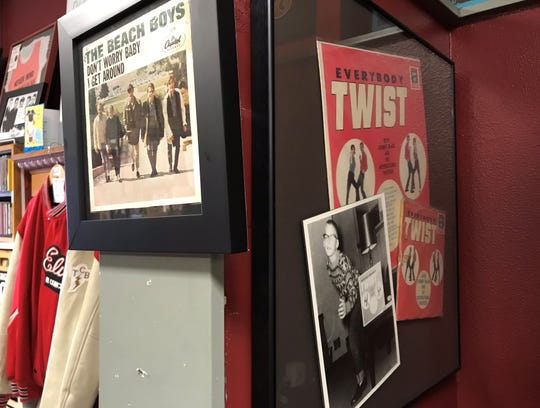 Some of the first records in owner Kit Close's collection are framed and hung behind the register at Ranch Records on Wednesday, June 24, 2020.