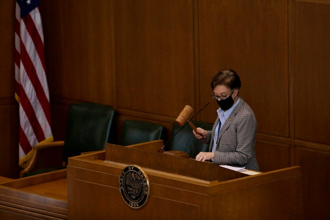 House Speaker Tina Kotek, D-Portland, holds the gavel during a meeting of the House of Representatives during a special session of the Oregon Legislature in the Oregon State Capitol building in Salem, Oregon, on Thursday, June 25, 2020.