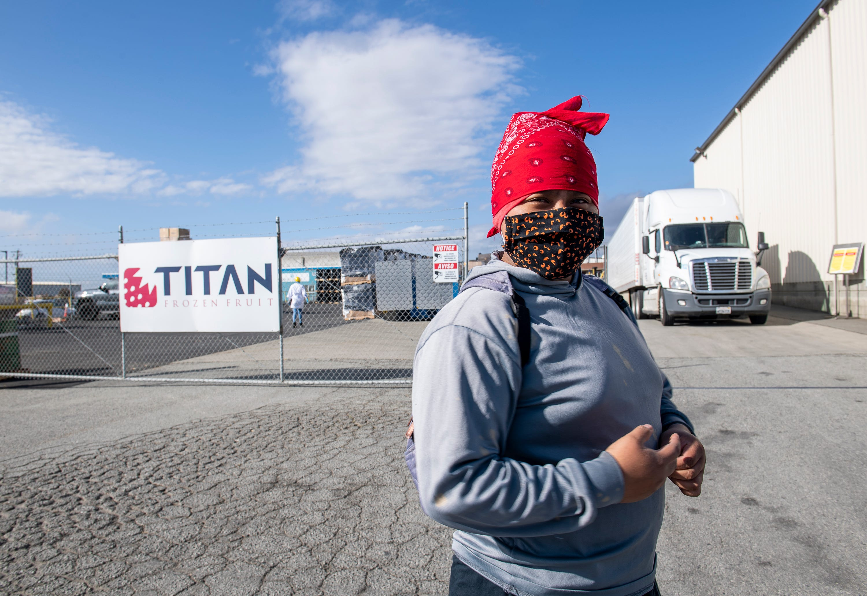 Resi Salvador, 19, waits in line to enter her new job at the Titan frozen fruit company. It is a summer job that she got to help her parents with the rent of their two-bedroom apartment in north Salinas, Calif.