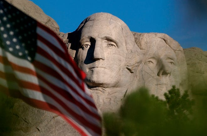 In this  file photo, the sun rises on Mt. Rushmore National Memorial near Keystone, S.D. President Donald Trump is planning to kick off Independence Day weekend in South Dakota with a show of patriotism -- fireworks popping, fighter jets thundering overhead and revelers crowding beneath a piece of classic Americana -- Mount Rushmore.