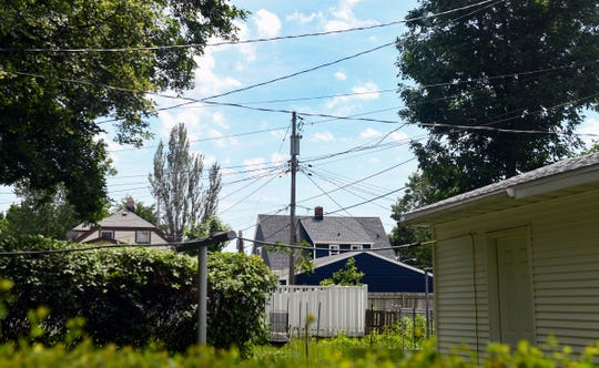 Power lines stretch between houses on Thursday, June 25, in the Whittier neighborhood in Sioux Falls.