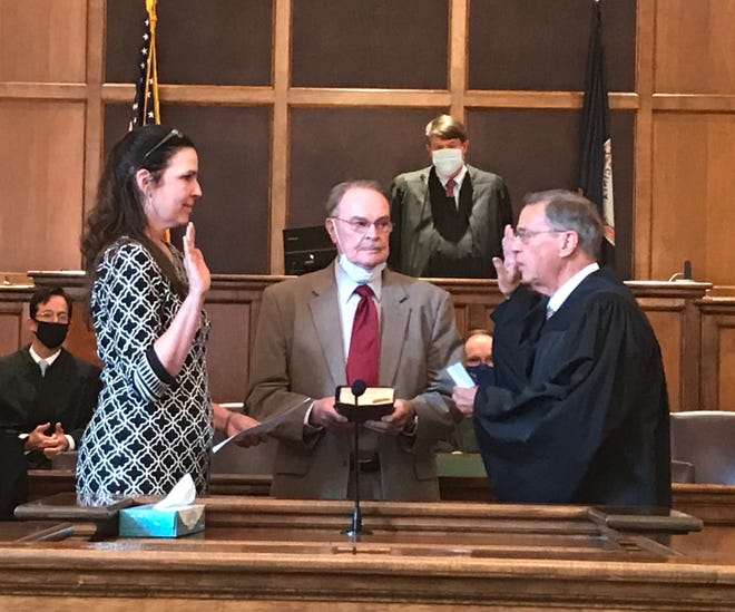 Anne Reed (left) is sworn in Wednesday afternoon in Staunton Circuit Court.