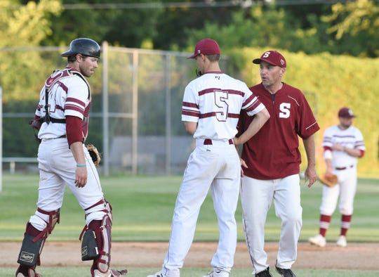 Springers manager Dave Hinkemeyer speaks with pitcher Nolan Notch and catcher Joe Dempsey in a game against Foley Wednesday, June 24, 2020, in Cold Spring.