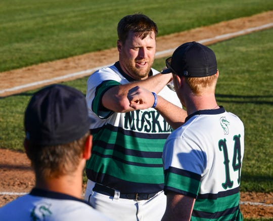 Tim Burns of the Sartell Muskies celebrates with team members after hitting a three-run home run in the third inning Wednesday, June 24, 2020, at St. Cloud Orthopedics Field in Sartell.
