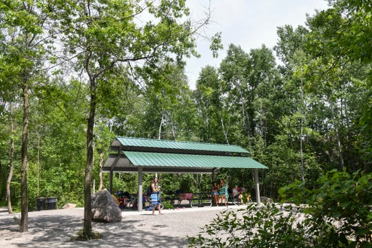 People use a newly-constructed shelter at the Melrose Deep Seven quarry Thursday, June 25, 2020, at Quarry Park in Waite Park.