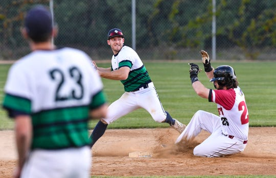 Teddy Fleming of the Sartell Stone Poneys slides into second as Andrew Deters of the Sartell Muskies tries to turn a double play Wednesday, June 24, 2020, at St. Cloud Orthopedics Field in Sartell.