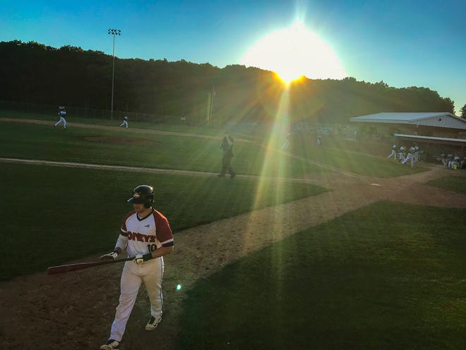 The sun sets as the Sartell Stone Poneys face the Sartell Muskies in amateur baseball Wednesday, June 24, 2020, at St. Cloud Orthopedics Field in Sartell.