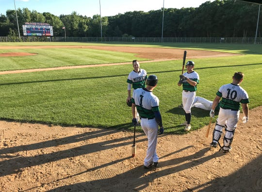 Sartell Muskies players warm up before the start of their game Wednesday, June 24, 2020, against the Sartell Stone Poneys at St. Cloud Orthopedics Field in Sartell.