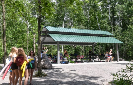 Swimmers use a newly-constructed shelter at the Melrose Deep Seven quarry Thursday, June 25, 2020, at Quarry Park in Waite Park. The shelter was built through donations by the family of former public planner Ken Hopke.
