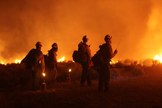 Fire crews fight the Mangum Fire between June 22 and 24.