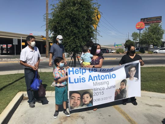 The family members of Luis Aragon-Alderete hold up a banner featuring his son, Luis Alderete-Martinez, who has been missing since 2015.