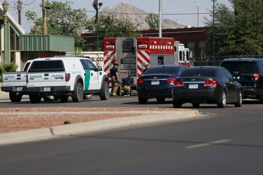 Firefighters are shown at the scene after seven people died and three were injured at 2:17 a.m. Thursday, June 25, 2020, in a crash during a Border Patrol chase in Downtown El Paso. Police Sgt. Robert Gomez said seven people died and three others were transported to hospitals.