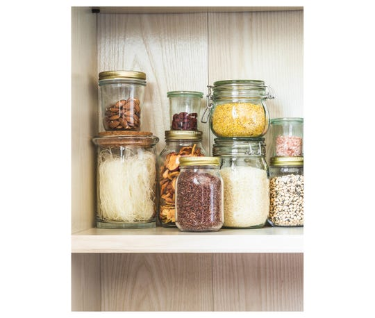 Shelf in the kitchen with various dry goods.