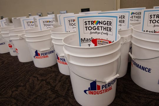 Five-gallon buckets filled with disinfectant, masks and other supplies are ready to go for free to business owners who need them at the Saratoga Springs City Center on Wednesday, June 24, 2020.