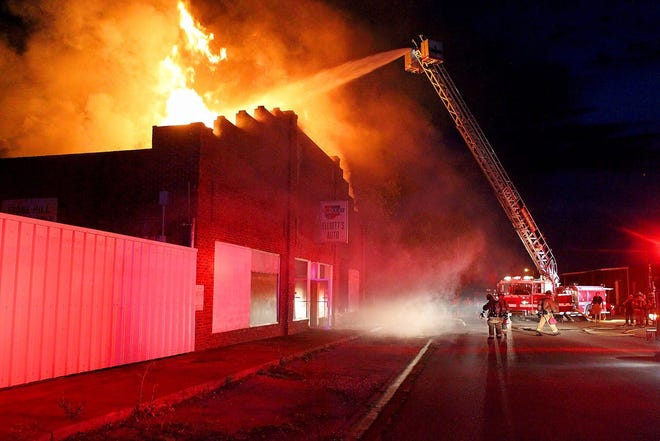 The Burkburnett Volunteer Fire Department battled a blaze, as shown in this June 7, 2017, file photo, that destroyed the Elliott's Auto building in downtown Burkburnett. Several fire departments assisted on the fire.