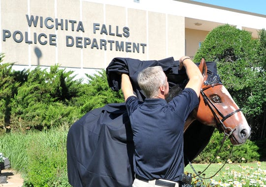 Deputy Chief Guy Gilmore said the horse, unveiled Thursday, will be permanently mounted on a pedestal near the police memorial in front of the police station on Holliday.