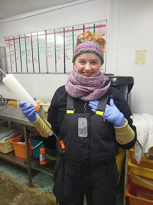 Molly Anne Chlovechok with a syringe used to feed seal pups. Chlovechok, a Cambridge High School, Hocking College and University of West Virginia graduate, works at Seal Rescue Ireland.