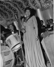 """Ella Fitzgerald performs onstage at the Savoy Ballroom in Harlem in 1940, in a still from the new documentary """"Ella Fitzgerald: Just One of Those Things."""""""