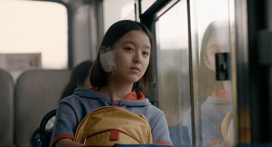"A lonely Korean girl (Park Ji-hu) navigates medical issues and romantic travails in the coming-of-age drama ""House of Hummingbird."""