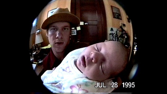 "A 真人百家家乐官网网站home video shows Blind Melon singer Shannon Hoon holding his baby daughter five months before his death in the documentary ""All I Can Say."""