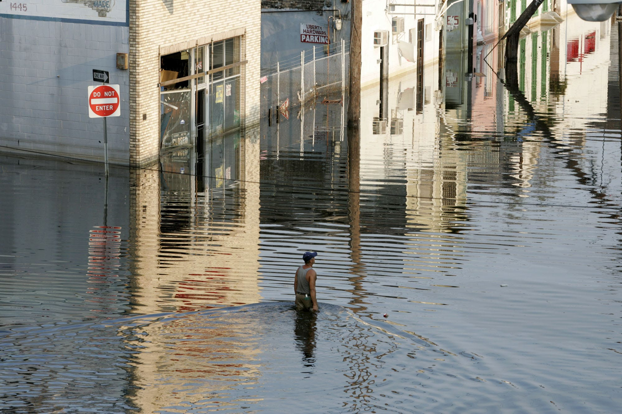 A lone man wades through the floodwaters in New Orleans north of downtown six days after Hurricane Katrina passed through the area.