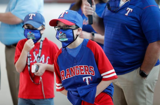 The Texas Rangers are considering allowing fans to attend games at their newly opened Globe Life Field when the season opens in July.