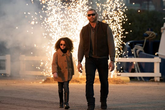 "Sophie (Chloe Coleman) and JJ (Dave Bautista) try to look as cool as they can in the action comedy ""My Spy."""