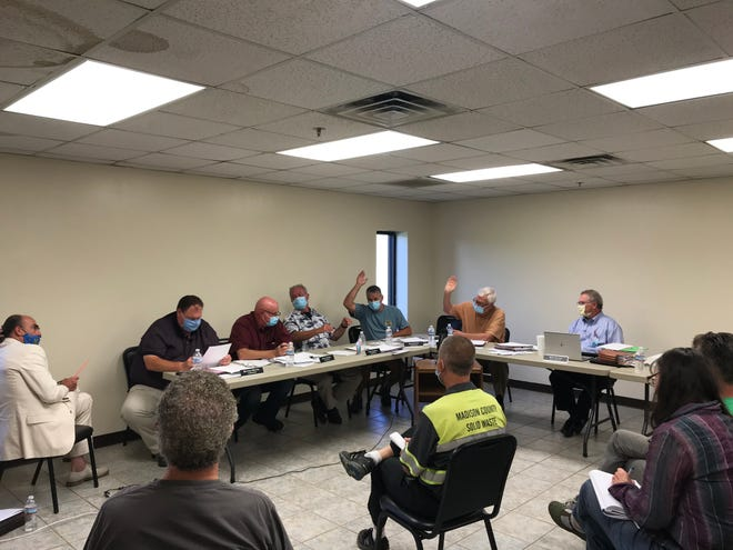 Commissioners Craig Goforth (leaning back), Mark Snelson and Norris Gentry (arms raised) voted in favor of a $20 increase in the dump card and a budget with a $1.1 million increase in property tax revenue.