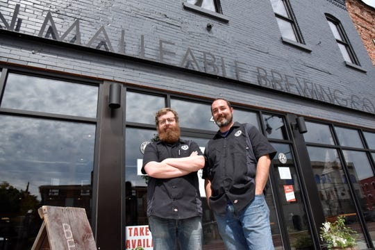 Charles Moreau and Ben Wade, co-owners of Albion Malleable Brewing Company, on Friday, June 26, 2020.