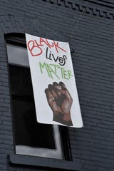 A Black Lives Matter banner hangs outside Albion Malleable Brewing Company in Albion on Friday, June 26, 2020.