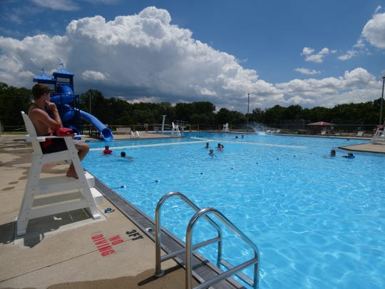 A lifeguard watches over the action at the Aumiller Park pool on Thursday, the pool's second day of operation.