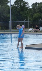 A younger swimmer dips her toes into the water at the Aumiller Park pool on Thursday.