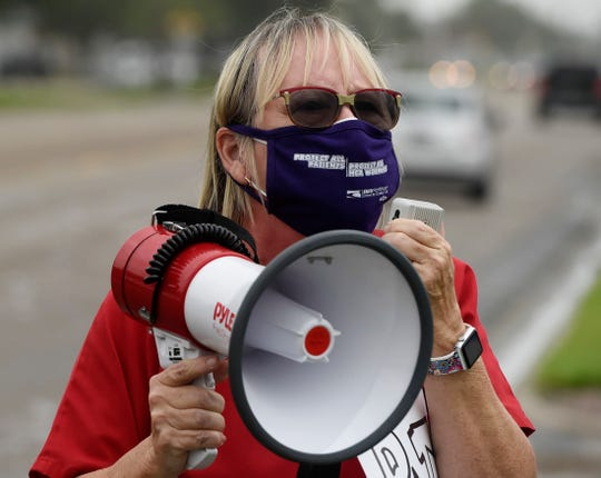 The Service Employees International Union and Hospital Corporation of America healthcare workers protest for more PPE and funding for patient care, Friday, June 26, 2020, in front of Corpus Christi Medical Center-Doctor's Regional. Nurses and health care employees attended the protest.