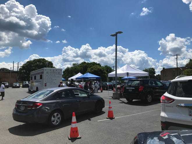 People drive up for free COVID-19 testing at a pop-up testing site in the West End. The state of Ohio has opened a July 14-16 pop-up test site in Avondale where anyone can walk-in and receive a free test.