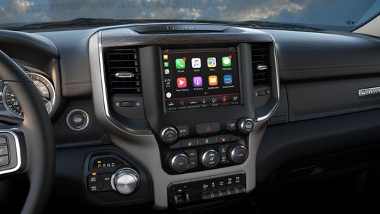 Apple CarPlay makes smart phone features available on vehicle touch screens.