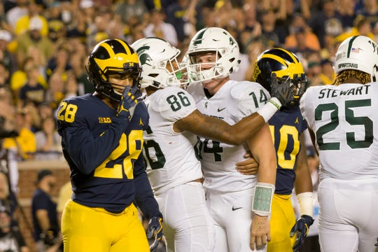 Brian Lewerke (14) and Michigan State defeated Michigan in 2018 in Ann Arbor.