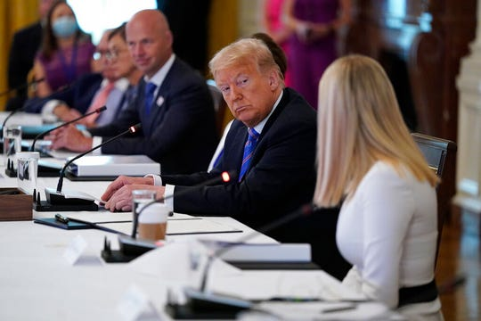 President Donald Trump listens as Ivanka Trump speaks during a meeting with the American Workforce Policy Advisory Board, in the East Room of the White House, Friday, June 26, 2020, in Washington.