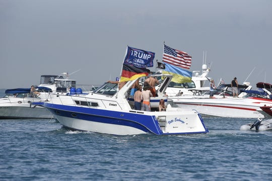 Early arrivals to Gull Island in the middle of Lake St. Clair begin the annual Jobbie Nooner boat party despite the threat of coronavirus exposure on Friday, June 26, 2020.