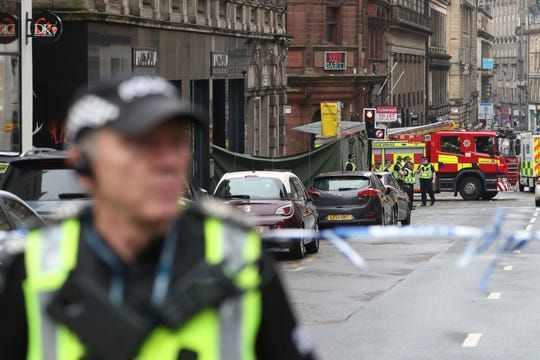 Emergency services attend the scene of an incident in Glasgow, Scotland, Friday.