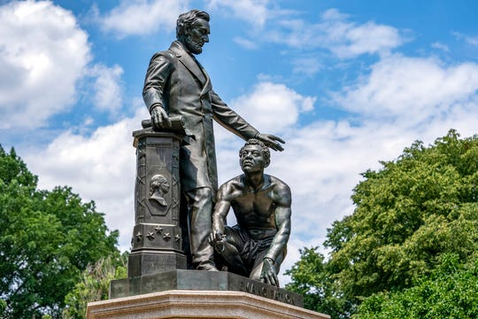 The Emancipation Memorial in Washington's Lincoln Park depicts a freed slave kneeling at the feet of President Abraham Lincoln, Thursday, June 25, 2020. Calls are intensifying for the removal of the statue as the nation confronts racial injustice.