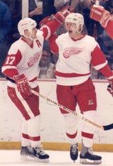 Red Wings forward Gerard Gallant, left, celebrates with Bob Probert at Joe Louis Arena.