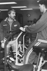 Red Wings assistant coach Don MacAdam, left, talks with Bob Probert at Joe Louis Arena on Nov. 19, 1986.