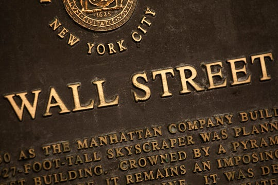 A historic marker for Wall Street is shown, Tuesday, May 26, 2020, in New York's financial district.