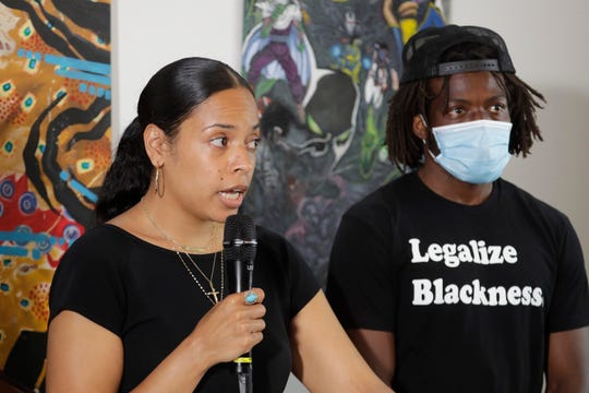 Naudia Miller, left, and Marcus Henderson, right, both of Black Collective Voices, speak Thursday, June 25, 2020, at a news conference in Seattle.