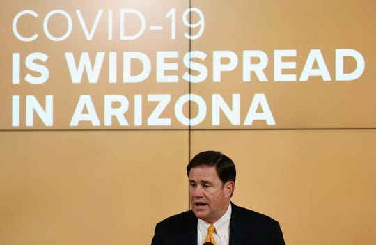Arizona Republican Gov. Doug Ducey speaks about the latest coronavirus data at a news conference Thursday, June 25, 2020, in Phoenix.
