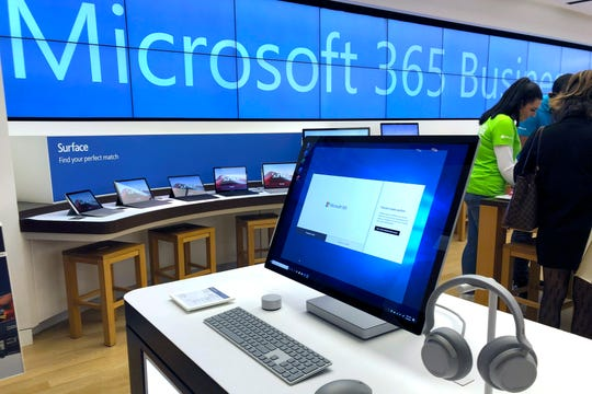 In this Jan. 28, 2020, file photo a Microsoft computer is among items displayed at a Microsoft store in suburban Boston.