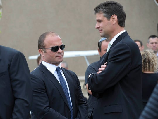 Former Red Wings forward Stu Grimson, right, talks with former Maple Leafs forward Tie Domi after the funeral service for Bob Probert at Christian Fellowship Church in Windsor on July 9, 2010.