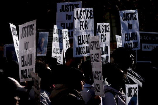 File-In this Nov. 23, 2019, file photo, demonstrators gather for a press conference at the Aurora Municipal Center after the police department released the body camera footage of Elijah McClain, who died after being stopped by three Aurora officers in August 2019.