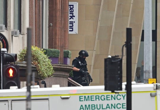 Armed police at the scene of an incident in Glasgow, Scotland, Friday.