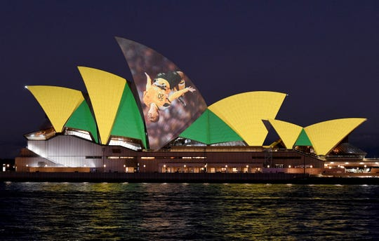 The Sydney Opera House is illuminated in support of Australia and New Zealand's joint bid to host the FIFA Women's World Cup 2023, in Sydney, Thursday, June 25, 2020.